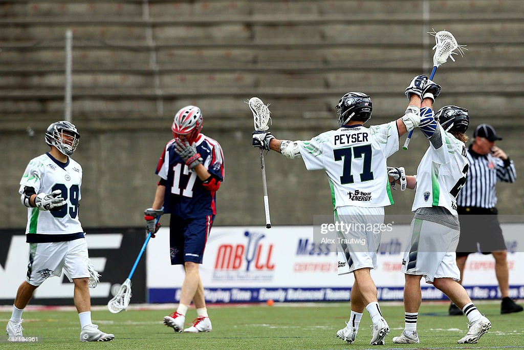 Stephen Peyser Brendan Mundorf and Matt Mackrides of the Chesapeake Bayhawks celebrate a goal against the Boston Cannons during a game at Harvard...