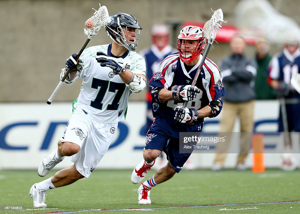 Stephen Peyser of the Chesapeake Bayhawks carries the ball as Brent Adams of the Boston Cannons defends during a game at Harvard Stadium on April 27...