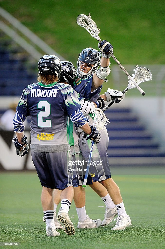 Stephen Peyser of the Chesapeake Bayhawks celebrates with teammates after scoring in the first quarter against the New York Lizards at NavyMarine...