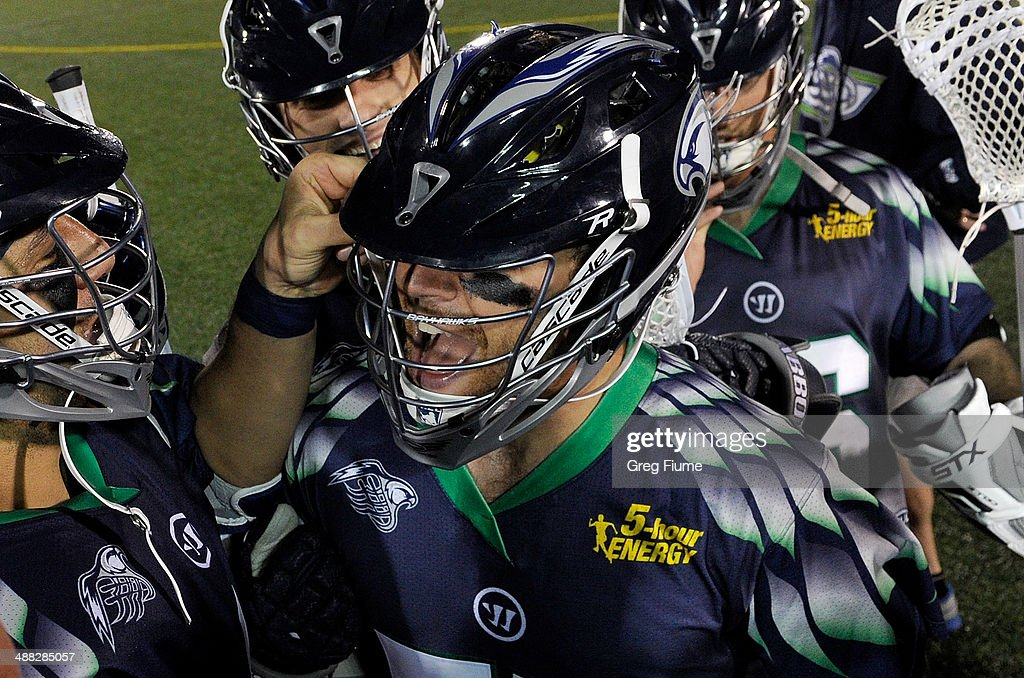 Stephen Peyser of the Chesapeake Bayhawks celebrates with teammates after scoring the game winning goal in overtime against the New York Lizards at...