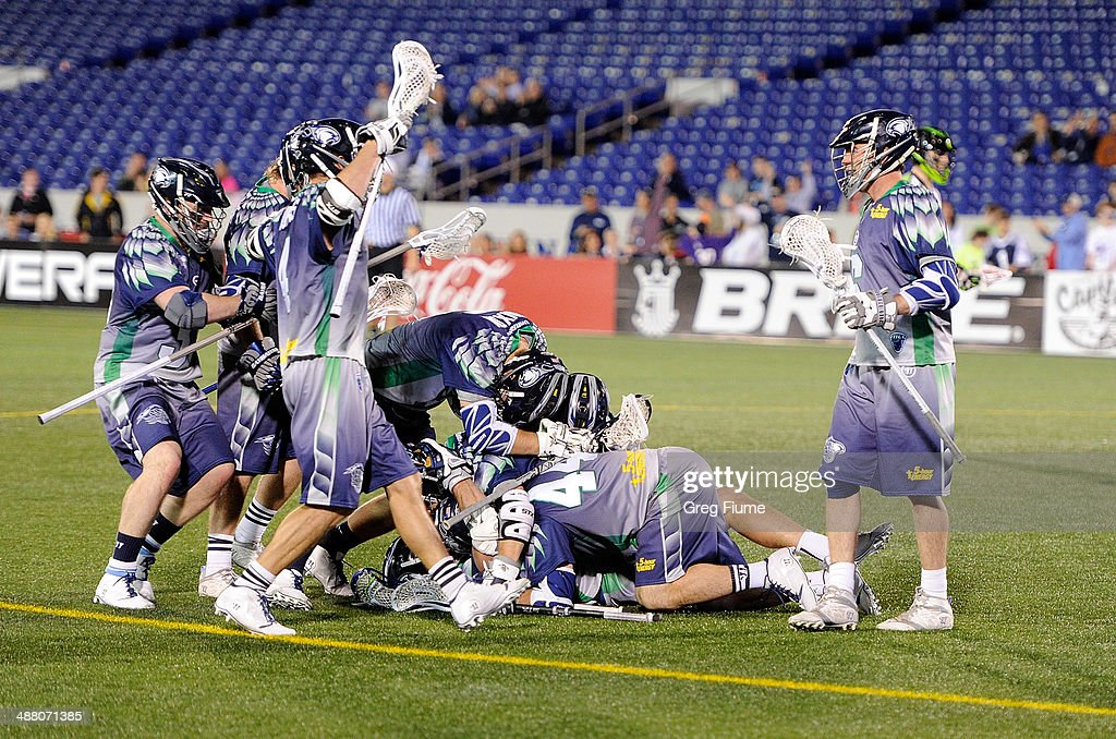 Stephen Peyser of the Chesapeake Bayhawks is mobbed by teammates after scoring the game winning goal in overtime against the New York Lizards at...