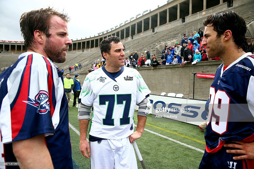 Stephen Peyser of the Chesapeake Bayhawks speaks with Ryan Boyle and Paul Rabil of the Boston Cannons after a game at Harvard Stadium on April 27...