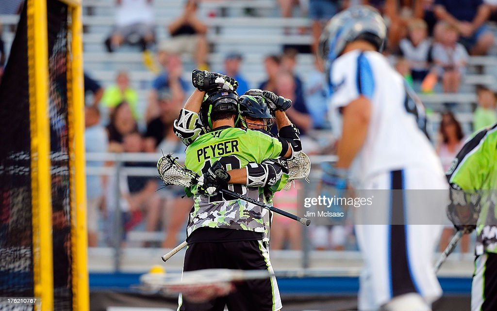 Stephen Peyser of the New York Lizards celebrates a goal against the Ohio Machine with teammate Rob Pannell during their Major League Lacrosse game...