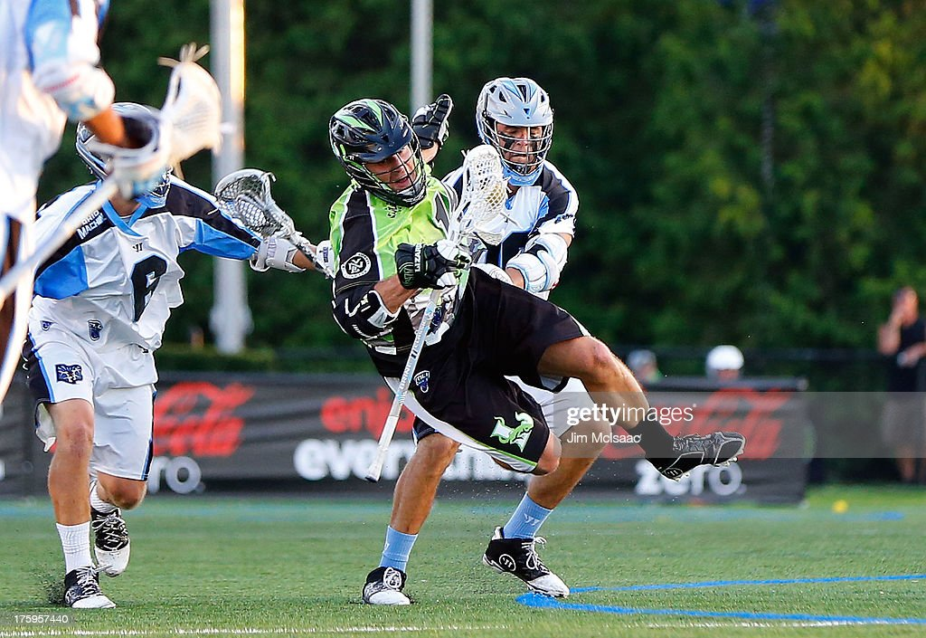 Stephen Peyser of the New York Lizards is checked by Logan Schuss of the Ohio Machine during their Major League Lacrosse game at Shuart Stadium on...