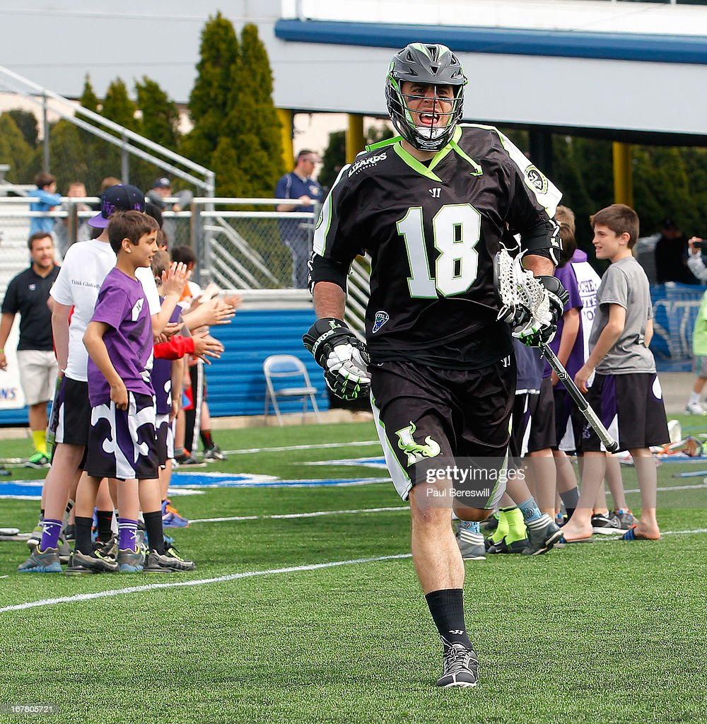 Stephen Peyser #18 of the New York Lizards runs onto the field during introductions before a Major League Lacrosse game against the Boston Cannons at James M. Shuart Stadium on April 28, 2013 in Hempstead, New York.