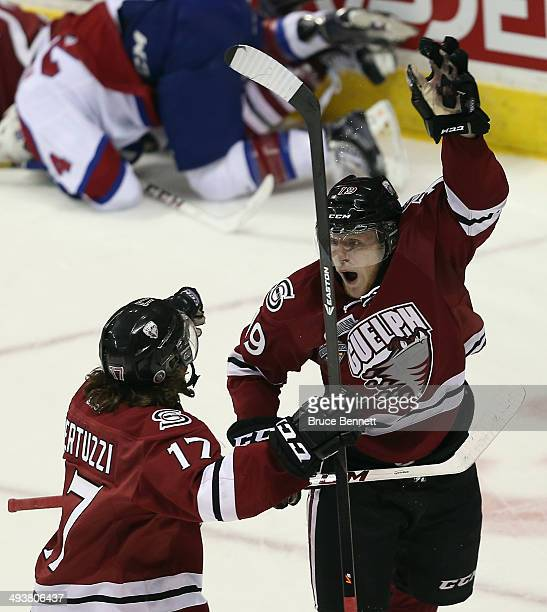 Stephen Pierog of the Guelph Storm scores a first period goal against the Edmonton Oil Kings and is joined by Tyler Bertuzzi during the first period...