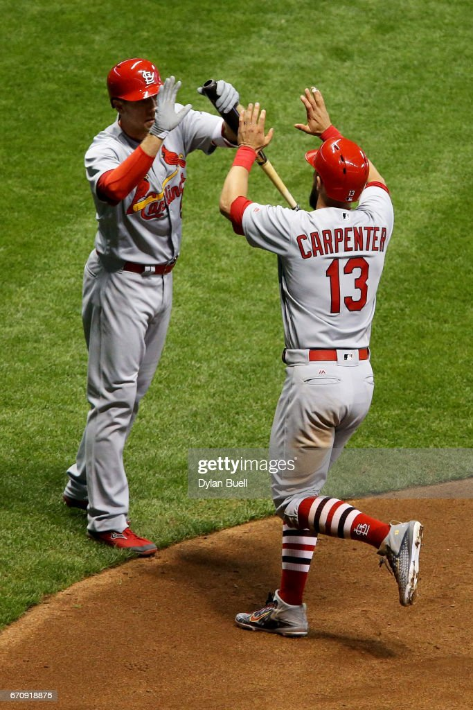 Stephen Piscotty #55 and Matt Carpenter #13 of the St. Louis Cardinals celebrate after Carpenter hit a home run in the fifth inning against the Milwaukee Brewers at Miller Park on April 20, 2017 in Milwaukee, Wisconsin.