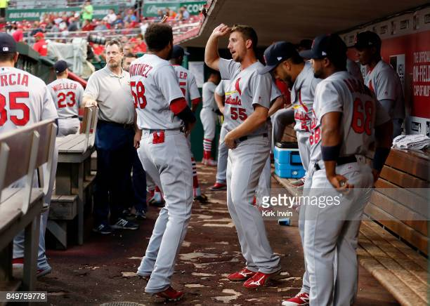 Stephen Piscotty of the St Louis Cardinals and Jose Martinez of the St Louis Cardinals dance after shaking hands with each other prior to the start...