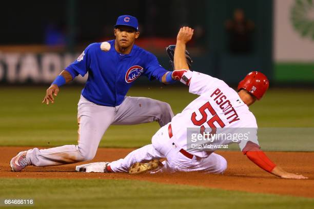 Stephen Piscotty of the St Louis Cardinals beats the throw to Addison Russell of the Chicago Cubs at second base in the fifth inning at Busch Stadium...