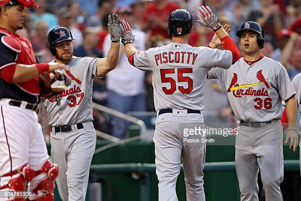 Stephen Piscotty of the St Louis Cardinals celebrates after hitting a grand slam home run against the Washington Nationals during the third inning at...