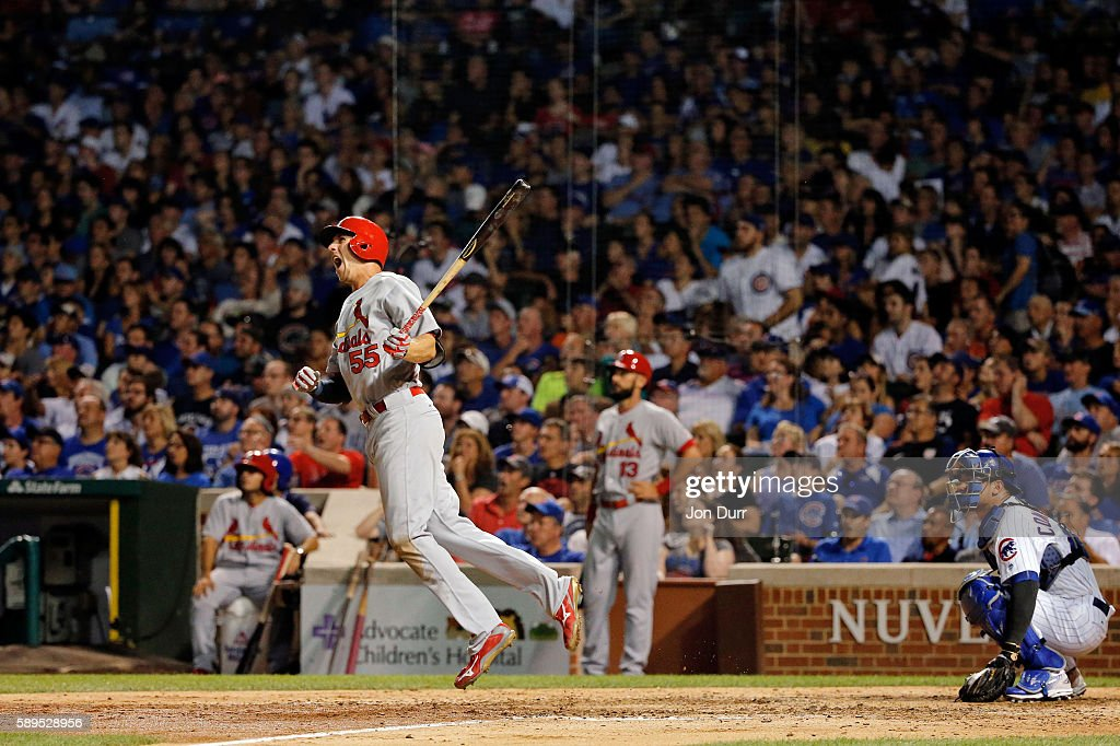 Stephen Piscotty #55 of the St. Louis Cardinals celebrates after hitting a three run home run against the Chicago Cubs during the eighth inning at Wrigley Field on August 14, 2016 in Chicago, Illinois.