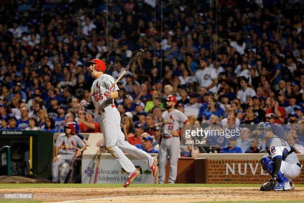 Stephen Piscotty of the St Louis Cardinals celebrates after hitting a three run home run against the Chicago Cubs during the eighth inning at Wrigley...