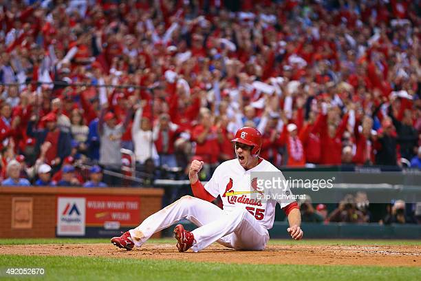 Stephen Piscotty of the St Louis Cardinals celebrates scoring a run in the first inning against the Chicago Cubs during game one of the National...