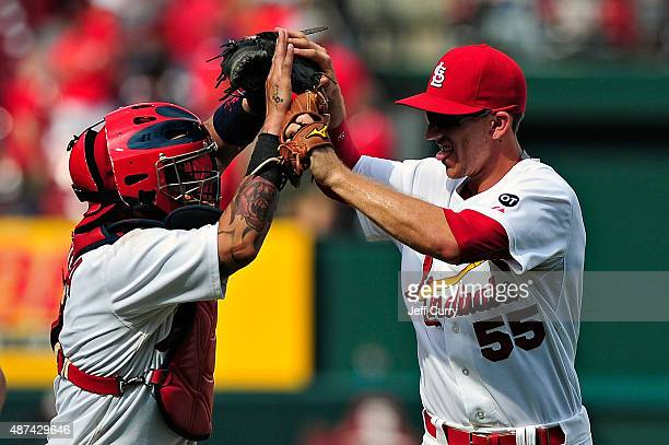 Stephen Piscotty of the St Louis Cardinals celebrates with Yadier Molina after defeating the Chicago Cubs 43 at Busch Stadium on September 9 2015 in...