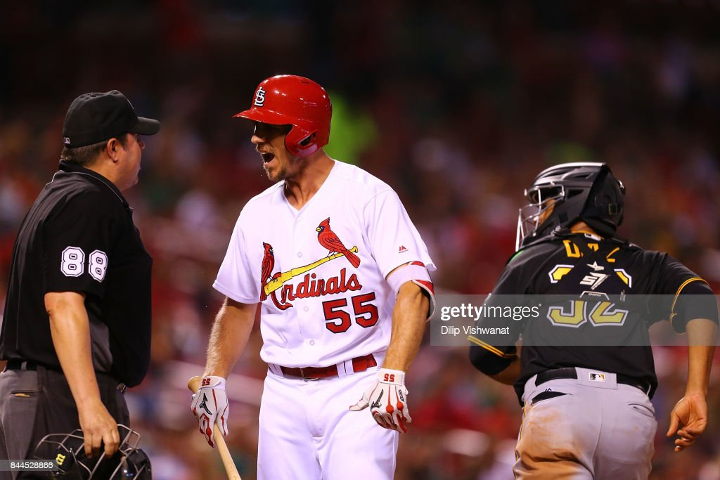 Stephen Piscotty #55 of the St. Louis Cardinals complains to umpire Doug Eddings #88 after striking out against the Pittsburgh Pirates in the seventh inning at Busch Stadium on September 8, 2017 in St. Louis, Missouri.