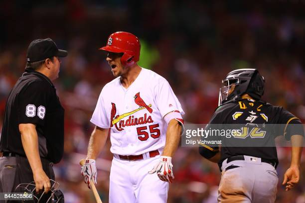 Stephen Piscotty of the St Louis Cardinals complains to umpire Doug Eddings after striking out against the Pittsburgh Pirates in the seventh inning...