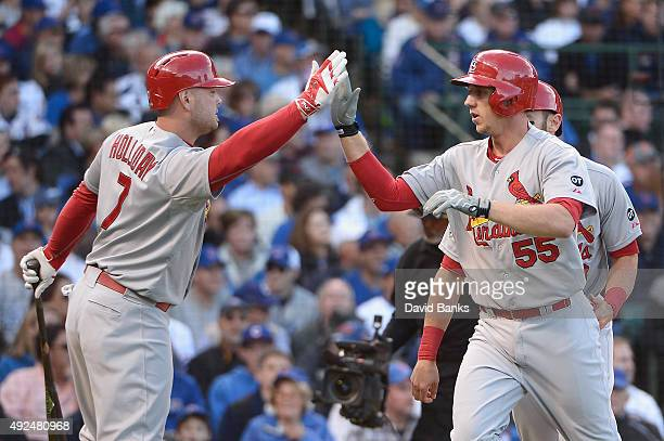 Stephen Piscotty of the St Louis Cardinals high fives Matt Holliday of the St Louis Cardinals after hitting a tworun home run in the first inning...