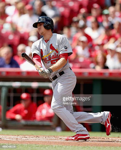 Stephen Piscotty of the St Louis Cardinals hits a single in the first inning during the game against the Cincinnati Reds at Great American Ball Park...