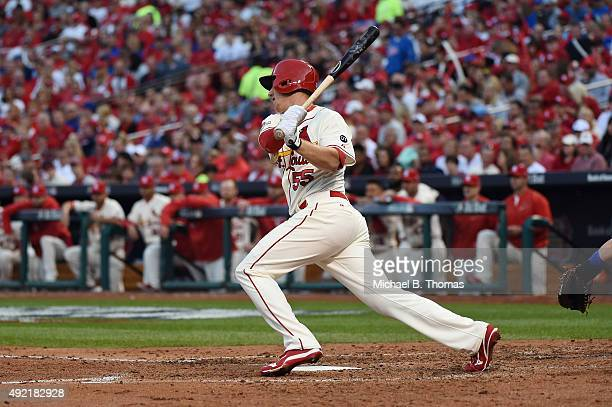 Stephen Piscotty of the St Louis Cardinals hits a single in the fourth inning against the Chicago Cubs during game two of the National League...