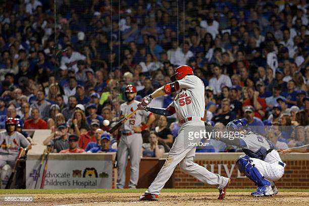 Stephen Piscotty of the St Louis Cardinals hits a three run home run against the Chicago Cubs during the eighth inning at Wrigley Field on August 14...
