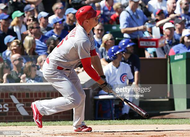 Stephen Piscotty of the St Louis Cardinals hits a two run home run off pitcher Jon Lester of the Chicago Cubs during the first inning at Wrigley...