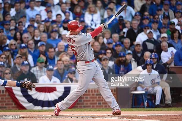 Stephen Piscotty of the St Louis Cardinals hits a tworun home run in the first inning against the Chicago Cubs during game four of the National...