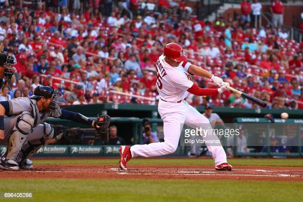 Stephen Piscotty of the St Louis Cardinals hits an RBI single against the Milwaukee Brewers in the first inning at Busch Stadium on June 15 2017 in...
