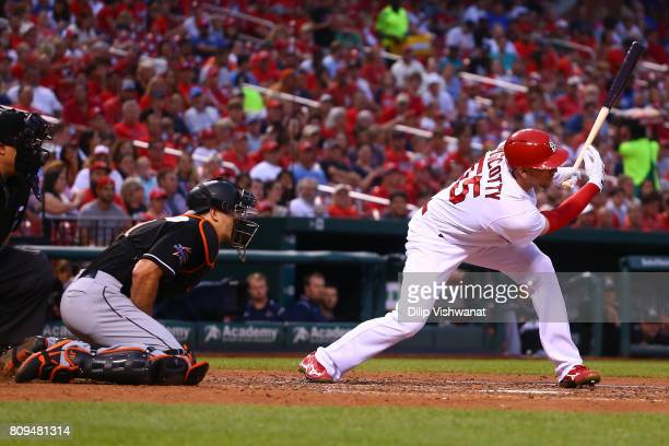Stephen Piscotty of the St Louis Cardinals hits an RBI single against the Miami Marlins in the third inning at Busch Stadium on July 5 2017 in St...