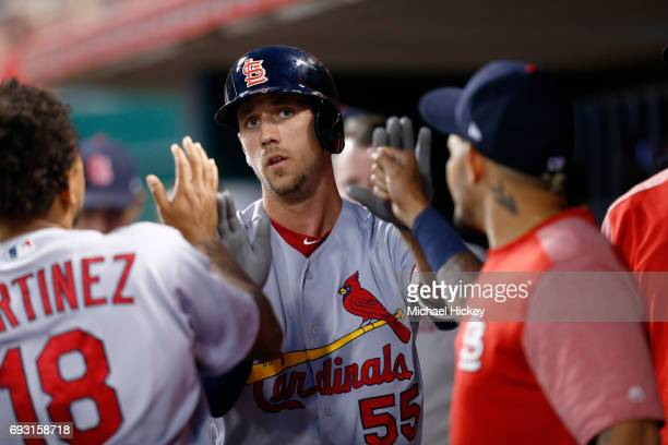 Stephen Piscotty of the St Louis Cardinals is congratulated by teammates after hitting a home run in the seventh inning against the Cincinnati Reds...