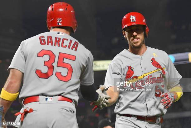 Stephen Piscotty of the St Louis Cardinals is congratulated by Greg Garcia after Piscotty hit a tworun homer against the San Francisco Giants in the...