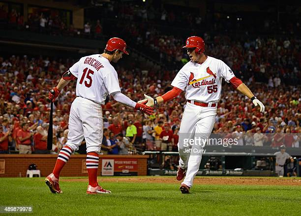 Stephen Piscotty of the St Louis Cardinals is congratulated by Randal Grichuk after hitting a solo home run against the Milwaukee Brewers during the...