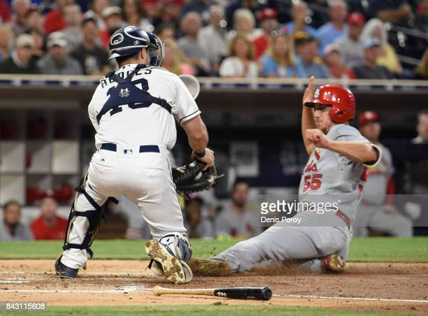 Stephen Piscotty of the St Louis Cardinals is tagged out at the plate by Austin Hedges of the San Diego Padres during the second inning of a baseball...