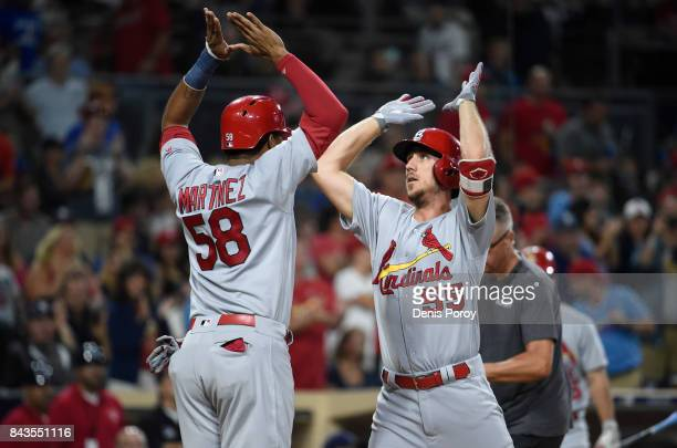 Stephen Piscotty of the St Louis Cardinals right is congratulated by Jose Martinez after hitting a tworun home run during the seventh inning of a...
