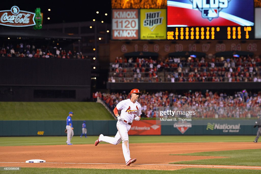 Stephen Piscotty #55 of the St. Louis Cardinals runs the bases after hitting a two-run home run in the eighth inning against the Chicago Cubs during game one of the National League Division Series at Busch Stadium on October 9, 2015 in St Louis, Missouri.