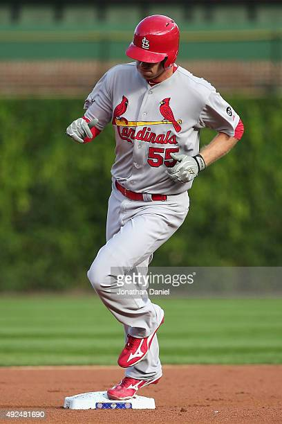 Stephen Piscotty of the St Louis Cardinals runs the bases after hitting a tworun home run in the first inning against the Chicago Cubs during game...