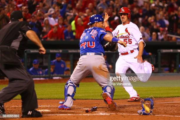 Stephen Piscotty of the St Louis Cardinals scores a run against the Chicago Cubs in the fifth inning at Busch Stadium on April 4 2017 in St Louis...