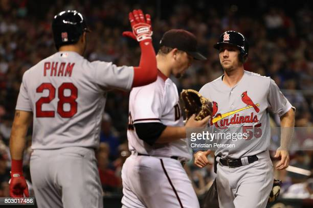 Stephen Piscotty of the St Louis Cardinals scores a run off starting pitcher Zack Godley of the Arizona Diamondbacks during the fourth inning of the...
