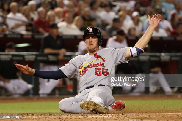 Stephen Piscotty of the St Louis Cardinals slides into home plate to score a run during the fourth inning of the MLB game against the Arizona...