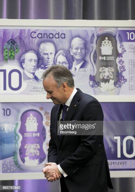 Stephen Poloz governor of the Bank of Canada reacts after unveiling a commemorative $10 note at Bank of Canada headquarters in Ottawa Ontario Canada...
