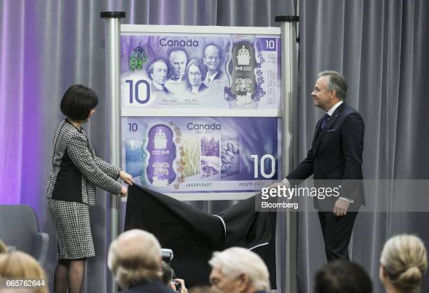 Stephen Poloz governor of the Bank of Canada right and Ginette Petitpas Taylor parliamentary secretary to Canada's finance minister unveil a...