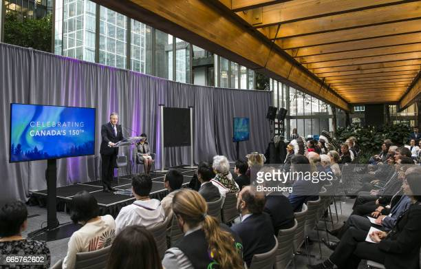 Stephen Poloz governor of the Bank of Canada speaks before unveiling a commemorative $10 note at Bank of Canada headquarters in Ottawa Ontario Canada...