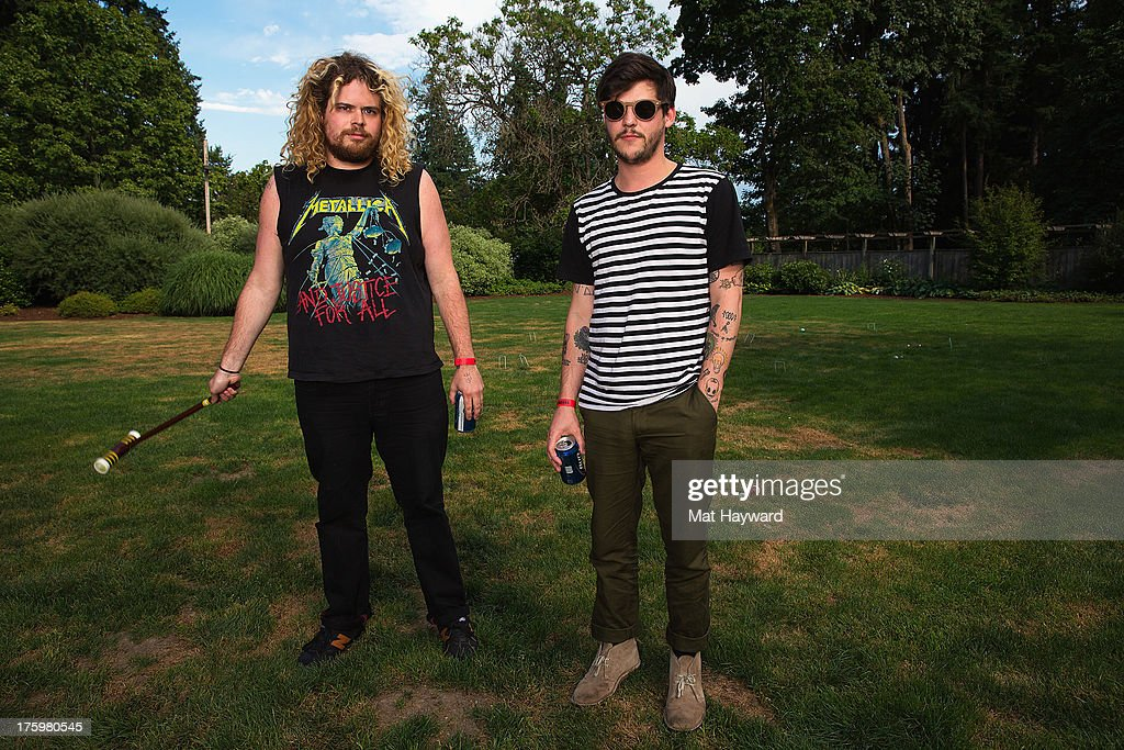 Stephen Pope (L) and Nathan Williams (R) of Wavves pose for a portrait backstage during Summer Camp hosted by 107.7 The End at Marymoor Park on August 10, 2013 in Seattle, Washington.