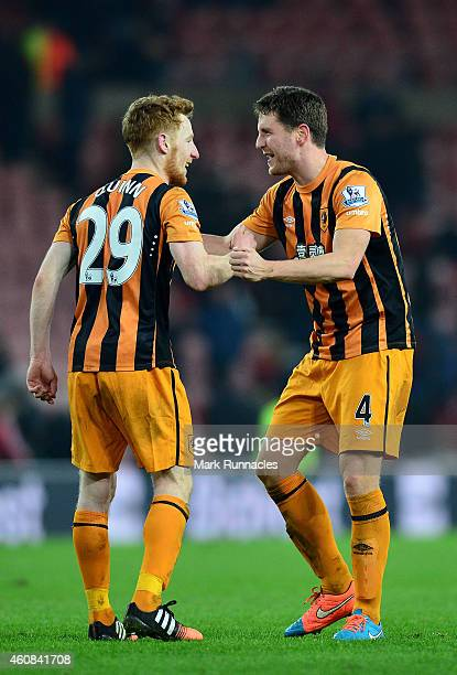 Stephen Quinn of Hull City and Alex Bruce of Hull City celebrate their team's 31 victory during the Barclays Premier League match between Sunderland...