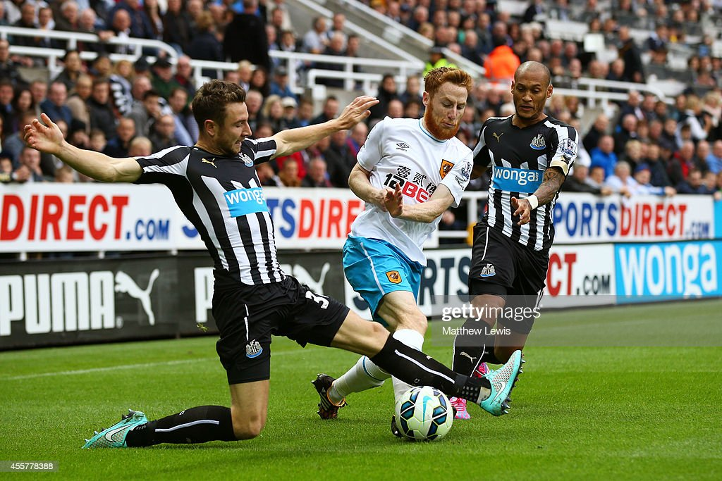 Stephen Quinn of Hull City is tackled by Paul Dummett of Newcastle United during the Barclays Premier League match between Newcastle United and Hull City at St James' Park on September 20, 2014 in Newcastle upon Tyne, England.