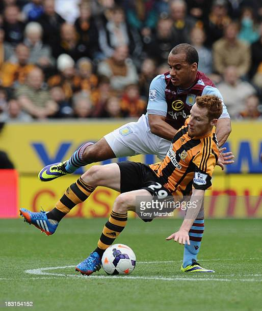 Stephen Quinn of Hull City vies with Gabriel Agbonlahor of Aston Villa during the Barclays Premier League match between Hull City and Aston Villa at...