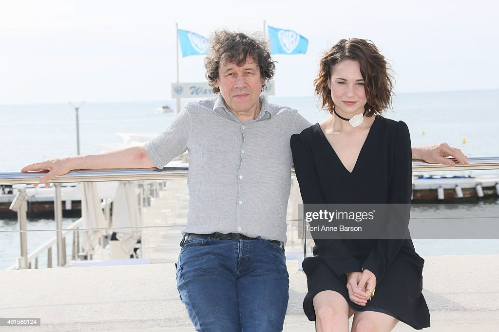 Stephen Rea (L) and Tuppence Middleton attend 'War & Peace' photocall on La Croisette on October 6, 2015 in Cannes, France.