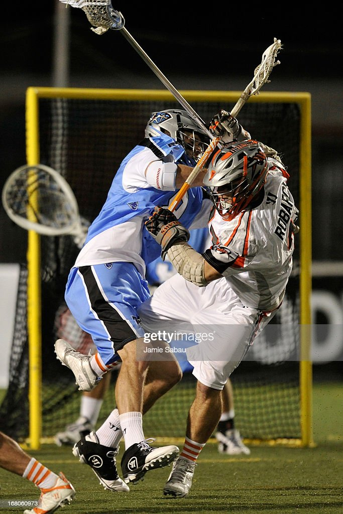 Stephen Robarge #37 of the Denver Outlaws collides with Max Schmidt #8 of the Ohio Machine in the second half on May 4, 2013 at Selby Stadium in Delaware, Ohio. Denver defeated Ohio 13-8.