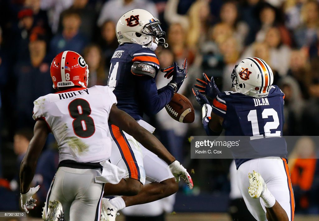 Stephen Roberts #14 and Jamel Dean #12 of the Auburn Tigers fail to intercept this pass intended for Riley Ridley #8 of the Georgia Bulldogs at Jordan Hare Stadium on November 11, 2017 in Auburn, Alabama.