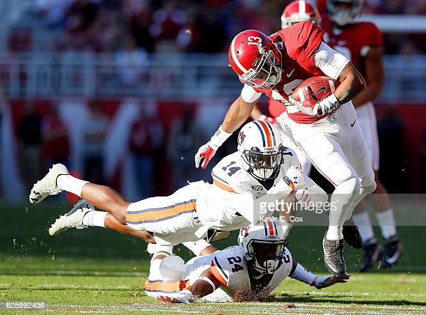 Stephen Roberts of the Auburn Tigers dives to tackle ArDarius Stewart of the Alabama Crimson Tide at BryantDenny Stadium on November 26 2016 in...