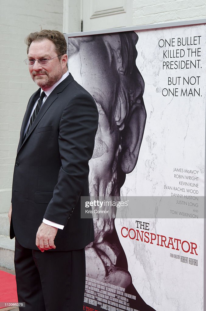 <a gi-track='captionPersonalityLinkClicked' href=/galleries/search?phrase=Stephen+Root&family=editorial&specificpeople=2359375 ng-click='$event.stopPropagation()'>Stephen Root</a> poses for photos on the red carpet during the premiere of 'The Conspirator' presented by The American Film Company, Ford's Theatre and Roadside Attractions at Ford's Theatre on April 10, 2011 in Washington, DC.